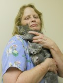 Boarding kennel attendant Debra Bunch cuddles kittens